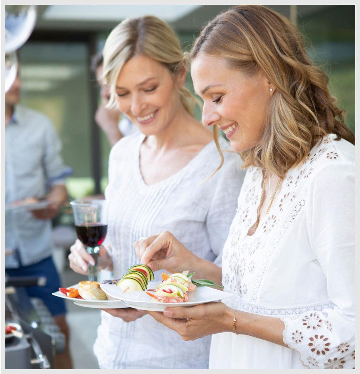 Two female friends choose tasty skewers.