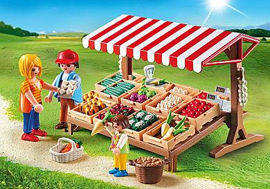 6121 Marchand avec étal de légumes