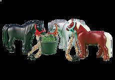 3 Ponys mit Futtertrog