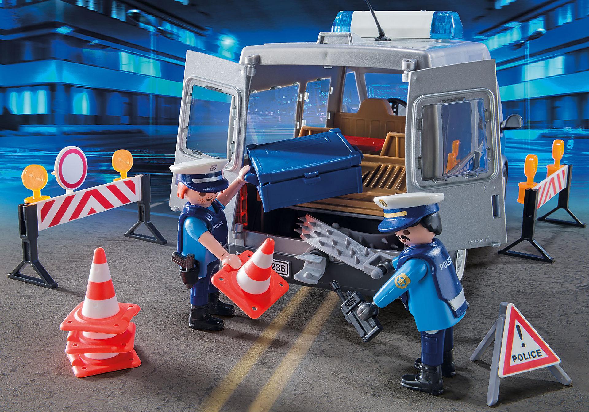 http://media.playmobil.com/i/playmobil/9236_product_extra1/Fourgon de policiers avec matériel de barrage