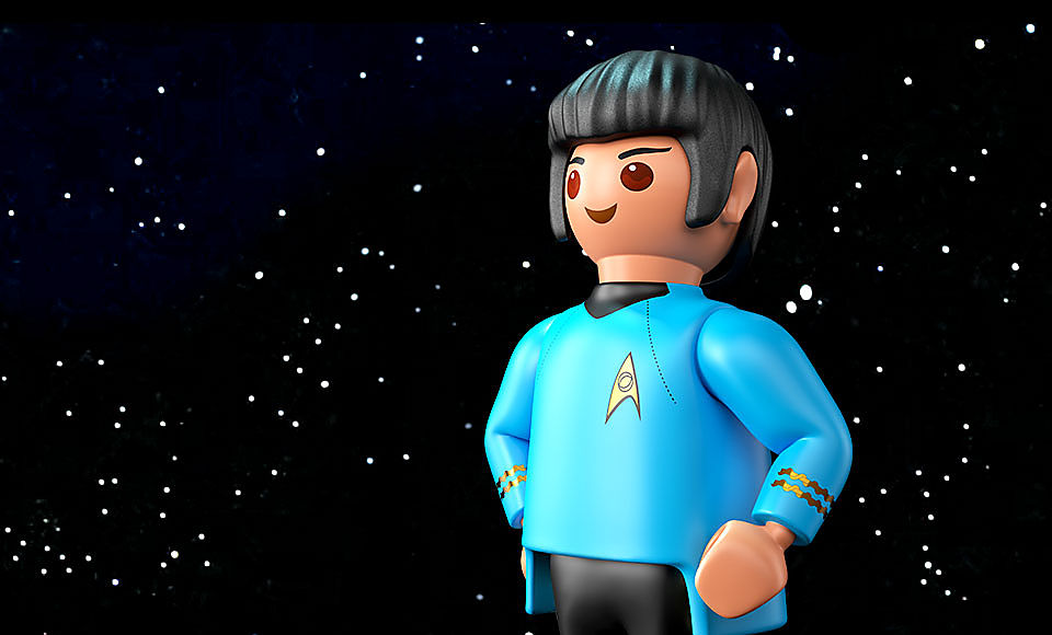 Shows 3D Playmobil Mr. Spock figure in front of a stars background