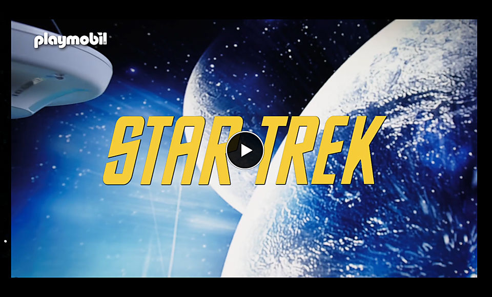 Video screen shows font STAR TREK in front of planets and stars. In the upper left corner you can see a part of the U.S.S. Enterprise NCC-170.                   Link to external page with promotional video